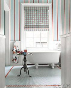 Striped and clean bedroom designed by Sheila Brides