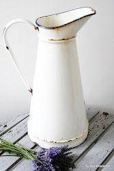 White enamel pitcher . . .
