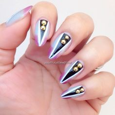 An edgy and fierce nail art design using Vanda a thermal polish as a base. Here I drew black triangles then outline with white. Added on round gold studs. Love the look? Get all the items at www.polishedbykpt.com