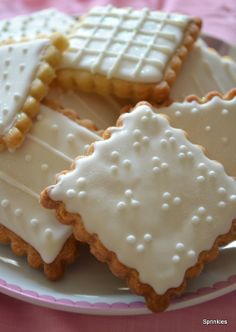 Sugar cookies iced with white royal icing