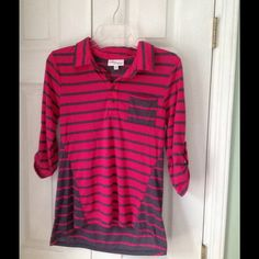 Dark pink and pink striped top. Pink and grey striped top.  Sleeves are three quarter and can be buttoned up.  This shirt is light and goes great with jeans. Tops Tees - Long Sleeve
