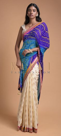 Buy Online from the link below. We ship worldwide (Free Shipping over US$100)  Click Anywhere to Tag Ivory Beige And Blue Half And Half Saree With Bandhani Print And Weaved Floral Buttis Online - Kalki Fashion Ivory beige and blue half and half saree in silk with weaved floral buttis on the pleats.Enhanced with weaved red border with kundan work