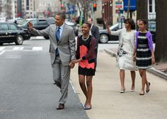 President Obama walks with his family from the White House to attend Easter Service at St. John's Church in Washington, D.C., Sunday, March 31, 2013