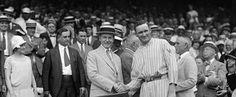 "US President Calvin Coolidge and Washington Senators pitcher Walter Johnson shake hands, presenting the ""American League diploma"" for the Senators winning the AL in 1924"