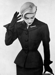 Model in elegant day suit by Bernard Sagardoy, cloche by Marie-Christiane, photo by Louis Astre, 1951