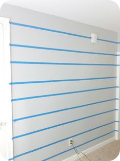 how to paint perfect horizontal stripes on your wall.   Where was this handy bit of information last week?!?!?!?
