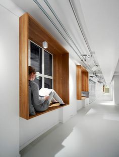 """Window seats, Netlife Research by Eriksen Skajaa Architects. An Open-Plan Office With A """"Monastery"""" For Quiet Reflection."""