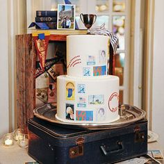 Vintage Stamp Wedding Cake | An antique suitcase served as a stand for this couple's wedding cake. Vintage stamps that the bride found on eBay were reproduced on the cake. | SouthernLiving.com