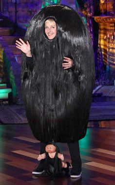 """Ellen DeGeneres from Best Celebrity Halloween Costumes  She's a dead ringer for Cousin Itt, but nope, the talk-show host explains: """"In case you don't know, I'm Snooki's pouf.  That's Snooki down there.  I'm the pouf.  She's the actual size. She is that short.  I met her in  person."""""""