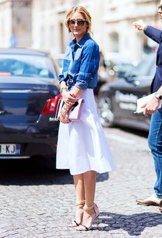 classic denim button-up tucked into a crisp white skirt