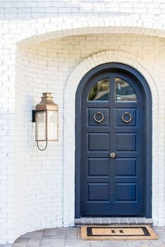 BECKI OWENS- Spring Curb Appeal: Painted Front Doors + Paint Guide Love this BM 1680 Hudson Bay navy blue door!