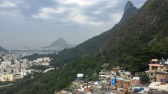 From the top of a favela, looking to the wealthy, gentrified suburbs below. #RIO #travel #poverty
