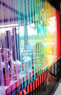 Rainbow Party. Tulle backdrop for back deck! great idea!!!!