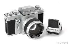 """Tokyo Kogaku Topcon RE Super.  When: 1963  Why: First TTL (through-the-lens exposure meter) SLR camera.    Though TTL was already on the market with non-SLR """"Mec 16 SB"""" camera, Topcon came in with several nice features: SLR (of course), interchangeable lens, interchangeable viewfinders, motor drive option. Currently, TTL is very important for SLR cameras mostly because of different interchangeable lens and different lens filters."""