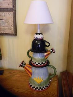 Upcycled lamp created from watering cans, saucers, and cups - by Karin Small