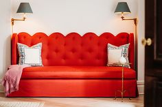scalloped tufted banquette, swing arm sconces.