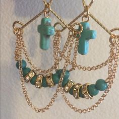Gold Tone and Teal Earrings Gold Tone and Teal Earrings with Clear Crystals.  Earrings are a little more than 3.25 inches long.  Item tag states not intended for children 14 and under. Jewelry Earrings