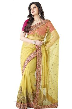 Yellow Sequins Embroidered Net Saree  Fabric: NetColor: Yellow More details  Reference : VLR5799 http://valehri.com/sarees/443-yellow-sequins-embroidered-net-saree.html