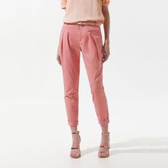 Zara Pink High Waisted Pleated Cropped Trousers M A lovely pair of lightweight, coral pink cropped pants from ZARA featuring pleats and elasticized leg openings. A perfect pant for warmer days to show off your ankles and cute shoes! Zara Pants