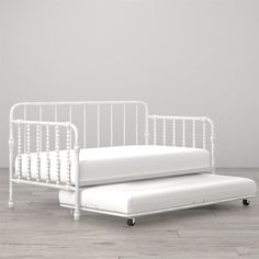 The Monarch Hill Wren Daybed with handy pull-out trundle is the perfect sleep solution. The sturdy metal frame is made especially for kids and built to withstand years of everyday wear and tear, and also features a slat system that provides extra support. The intricate scroll design and rounded edges add a touch of whimsy and comes in your choice of ideal for any room! Prop the daybed with cushions for a handy place to sit and read, do homework or play by day, then tuck in at night for a…