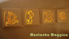 Quadros em MDF laqueados, tema safari Possui iluminação interna de LED que funciona com 02 pilhas AA já inclusas. VALOR REFERENTE AOS 04 QUADROS. CLIQUE NAS FOTOS AO LADO PARA APLIAR A IMAGEM E CONFERIR MAIS OPÇÕES