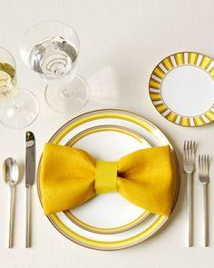 servietten falten - gelbe schleife