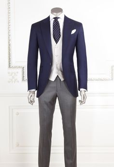 Another variation for anyone but those in ceremony - the coat and tie are blue, the trousers are a little lighter grey, and the vest is cream.