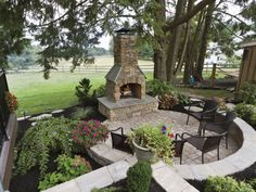 Create the ultimate outdoor fireplace setting with this design made from Cast Veneer Stone.  www.ephenry.com