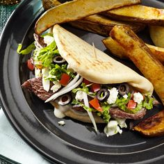 Beef Gyros Recipe -Going out to restaurants for gyros got to be expensive for our family, so I came up with this homemade version. Usually, I set out the fixings so everyone can assemble their own. My husband and our two busy teens request them often. —Sheri Scheerhorn, Hills, Minnesota
