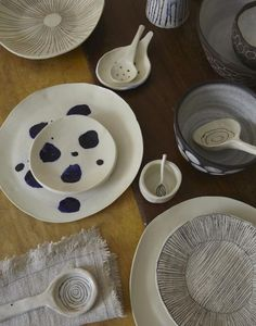 Handmade by Paula Greif, collection of dishes, spoons, and a napkin