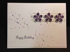 Simple purple spots with 3 purple punch flowers with pearls on the left birth card