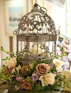 would love to have flowers styled like this around the base of our card holding bird cage.