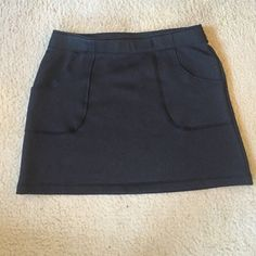 Black Athleta skirt with pockets tennis skirt This skirt is super comfy, and in great condition. Two front pockets on hips, and there is one inside for your key. Size medium, although I think it is a little big. Soft inside. The tag says tear away before you play 93% polyester 7% spandex. Great condition only wore twice Athleta Skirts Mini