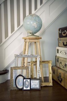 vintage globe, picture frames and suitcases. would work as a cute theme.