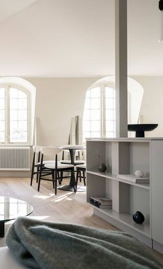 A beautiful Swedish attic home with contemporary furniture in white with black accents and a minimal kitchen #nordicinterior Nordic Interior, Modern Interior, Modern Decor, Round Dining Table Sets, Small Workspace, Minimal Kitchen, Black Accents, Dining Room Design, Nooks