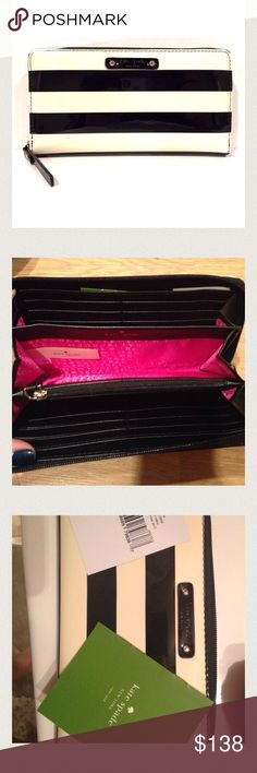 """NWT Kate Spade Striped Zip Wallet Brand new! Kate Spade Wallet. Shiny patent with black and cream stripes and hot pink interior. Tag and care card inside, wallet was ordered online. FEATURES zip around continental wallet 12 credit card slots, 2 billfolds, zipper change pocket and exterior slide pocket  DETAILS 4""""h x 7.6""""w x 0.8""""d kate spade Bags Wallets"""