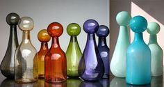 I'm not much of a liquor lover (more of a wino), but I'm aching for these gorgeous glass decanters by sculptor and designer Elizabeth Lyons. I don't think I'd even bother filling them; they're delectable as is. The vibrant colors of the hand-blown glass