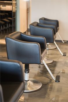 An eight-foot glittering chandelier and one-of-a kind marble-finished flooring welcomes clients to Hermosa Salon in Edmond, Oklahoma, one of our 2017 Salons of the Year. Salon Styling Chairs, Salon Chairs, Stylist Chair, Salon Software, Cozy Chair, Black Ceiling, Salon Furniture, Video Games For Kids, Floor Finishes