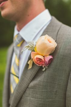 Peach Garden Rose Boutonniere the groom's boutonniere will be an orange ranunculus, pink astilbe