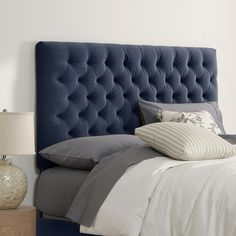 Whether it's in a first apartment or updated guest suite, this button-tufted headboard offers the perfect finishing touch for any space. Pair it with crisp s...