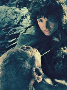 """Frodo and Gollum """"Release him or i'll cut your throat."""""""