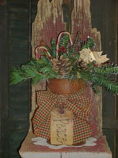 Old Barn Wood...with rusty pot filled with pine & grunged candy canes.