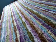 This afghan was something I came up with because I wanted a very quick and very easy pattern that could be done by touch - it's repetitive a...