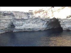 Exploring St Mary's Caves on Comino from the water