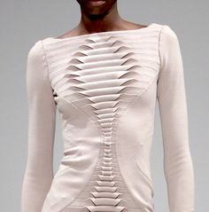 Dress with interesting use of fabric manipulation to create a textured pattern through folds // Georgia Hardinge