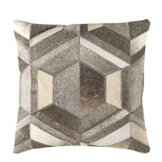 As Shown: Cowhide Pillow 1 Size: 18 x 18 inches Material: Hair-On Cowhide  Description: A diamond in the rough, this pillow brings together seamed strips of white, cream and shades of grey hair-on cowhide to form the perfect pillow. Perfectly faceted for the ultimate comfort in your interior.