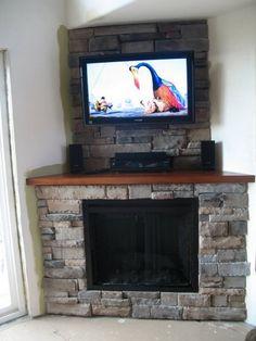 Simple design stone tile corner fireplace tv over fireplace