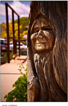 Smile of an old indian woman carved in the wood in Utah
