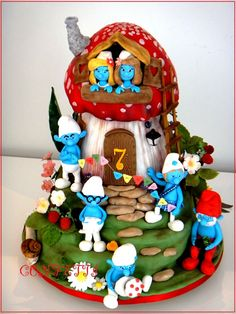 This is the cake I made for my beautiful twin girls slumber party. All things Smurf are the craze this year, and, obviously, one Smurfette wasnt enough, so I proudly present to you.... Smurfine!!! This is how Annie, my brown haired,brown eyed beauty decided to call her :). Ill post more detailed pictures a bit later!