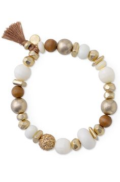 stretch bracelet with beads of gold pave, wood, ivory acrylic, and golden nuggets.